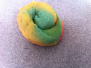 Rainbow biscuits rolled into a snail