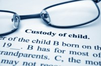 Custody of child papers with reading glasses