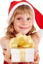 girl with present wearing a santa hat